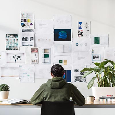 project manager at desk with storyboards